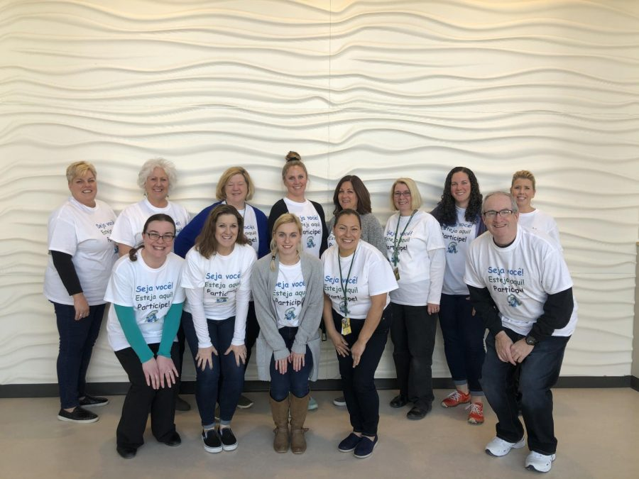 Abington High School teachers and staff show their support for English language learners by wearing T-shirts on Monday, March 2, 2020 that say