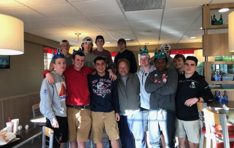 Abington High School's Lacrosse team enjoys time together at Burger King in May of 2019 after seeing a movie together. Left to right (front row): Chris Tosone '19, Matt Long '19, Dylan Magararu '19, Coach Tom Flanagan, Colin Leary '19, Josiah Rosa '19, Tom Furness '20, and Joe McCarthy '20. Back row left to right: Jake Wilkinson '19, Shon Doherty '21, Mark Cashman '21, Colin McDonald '20, and Dave McArthur '21.