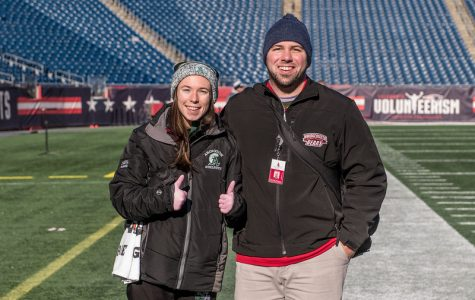 Abington High School athletic trainer Ms. Alicia Reid stands with Bridgewater State University's student trainer Dave at Gillette Stadium for the Abington football game on December 7, 2019.