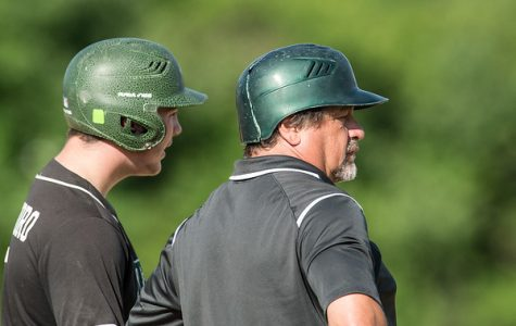 Brady Cristoforo, a junior at Abington High (left) and head coach Steve Perakslis (right) have a conversation on third base on June 17, 2019 in a showdown against St. John Paul at Braintree High School.