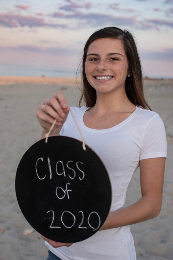 Senior+Allison+Clark+of+Abington+High+School+poses+for+her+senior+portrait+at+Rexhame+Beach+in+Marshfield%2C+Massachusetts+on+August+1%2C+2019%2C+unaware+that+her+senior+year+attending+school+would+be+interrupted+by+the+COVID-19+pandemic.