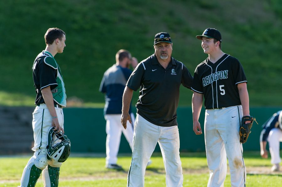 Coach Steve Perakslis (center) with his players Christian Labossier (left) and Brady Cristoforo (right) in 2018.