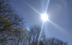 The sun shines over budding trees on Thursday, April 23, 2020 in Abington, Massachusetts.