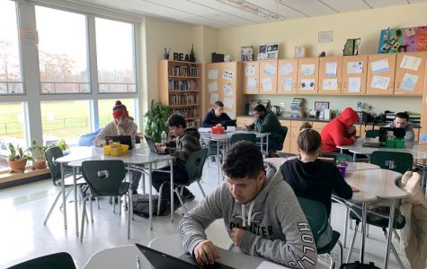 Senior Joao Carlos Andrade (front) works on his classwork in Bridge Block at Abington High School  fall of 2019.