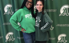 Abington seniors Linda Daye (left) and Michaela Kane show their Green Wave pride on November 27, 2019.