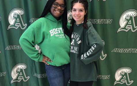 Abington seniors Linda Daye (left) and Michaela Kane show their Green Wave pride on November 27, 2019.