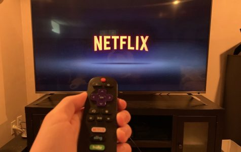 Derek Tirrell starting up Netflix using a Roku remote at his home in Abington Massachusetts on Thursday May 7 2020