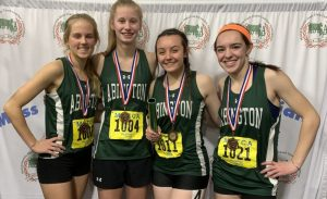 The Abington Girls 4x200m relay team comprised of (left to right) sophomore Kaylie Groom, junior Kaylee Carver, senior Kayla Larkin-Goldman, and sophomore Maria Wood. They placed 3rd at the South Shore League Championships on 1/30/20 at the Reggie Lewis Center in Roxbury, MA