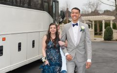 Cam Curney (right) escorts Sam Johnson to Canoe Club Ballroom for the 2019 Junior Class Prom in East Bridgewater on Friday, March 29, 2019. Curney was named Prom King.