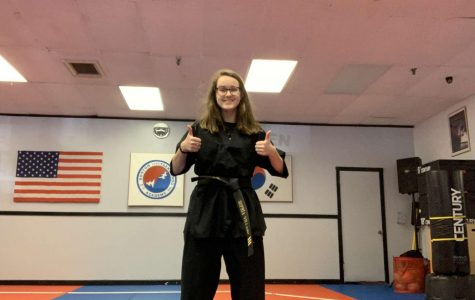 Sophia Villano preparing to virtually stream a lesson at the Boston Taekwondo dojo, in Abington Massachusetts,  on Thursday, May 7, 2020