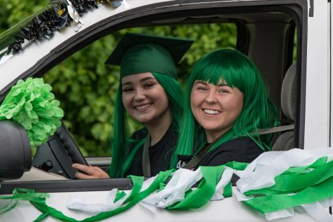 Abington High School seniors Talia McAuliffe (left) and Jessica Rix participate in the Senior Parade on Saturday, June 6, 2020 around the town of Abington.