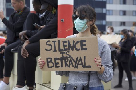 Black Lives Matter protester holding a sign in Rotterdam, Wednesday, June 3, 2020.