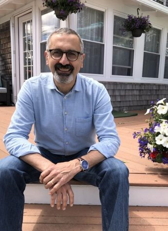 Mr. Mike DiRado sits on the steps of his house on June 1, 2020. This is his last year as the director of the Art department at Abington Public School.s