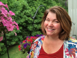 Mrs. Andrea Clifford poses on the back porch of her home on Wednesday, June 10, 2020. This is her final year as an English teacher at Abington High School.