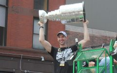 Boston Bruins captain and defenseman Zdeno Chara hoists the Stanley Cup on June 18, 2011 during a victory parade in Boston