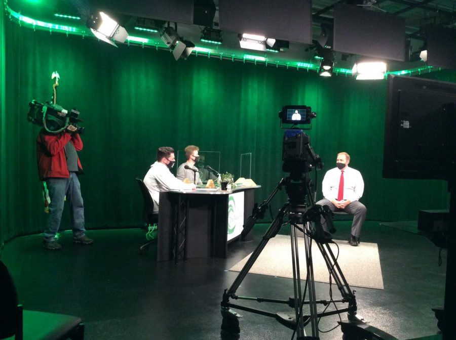 Chronicle TVs cameraman Scott takes some shots of the Green Wave Gazette's Digital Team Matthew Lyons (left) and Aaron Johnson (center) as they co-host their show The Weekly Wave on October 20, 2020, featuring Mr. Jonathan Bourn (right).