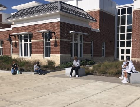 "Abington High School English teacher Ms. Erin Slayton, left, accompanies her freshmen outside to read Jeannette Walls memoir ""The Glass Castle"" on Thursday, October 15, 2020."