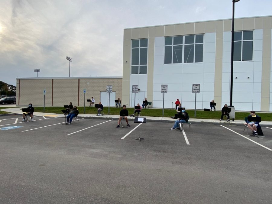Abington High School Band, directed by Mr. Steve Shannon, meets for class in the parking lot outside the back of the gym at Abington High School in the fall of 2020. Students have been following the guidelines of the Board of Health due to the Covid-19 pandemic.