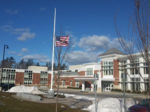 The United States flag in front of the Abington Middle-High School, waves at half-staff on February 25, 2021.