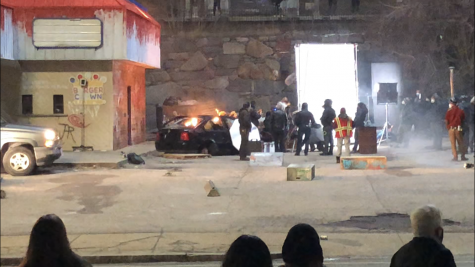 Spectators catch a glimpse of the filming of Adam McKay