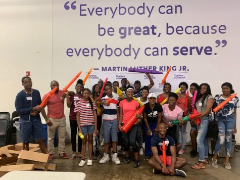 Abington High School junior Chimaobi Igwe (far left) with a group of his friends at Cradles to Crayons warehouse in Newtonville on July 14, 2020.