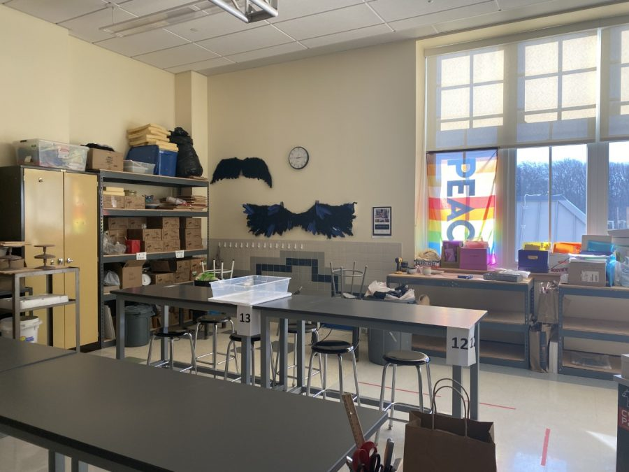 This room belongs to one of the two art teachers at Abington High. This teacher has photos of children on the door into her class.