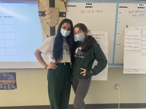 Abington High School junior Gabriela Maciel and sophomore Madison Carini (left to right) wear Abington colors and insignia to celebrate Abington Pride on the last day of Spirit Week on Friday, April 30, 2021.