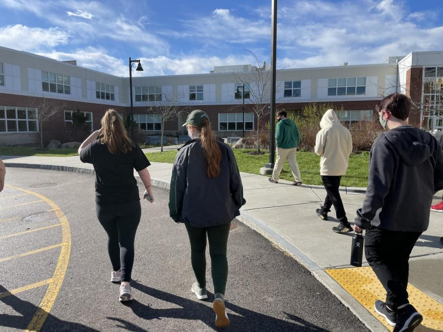 Members of the Abington High School Concert Band take a break from playing in the auditorium to take a walk around the building on April 30, 2021.