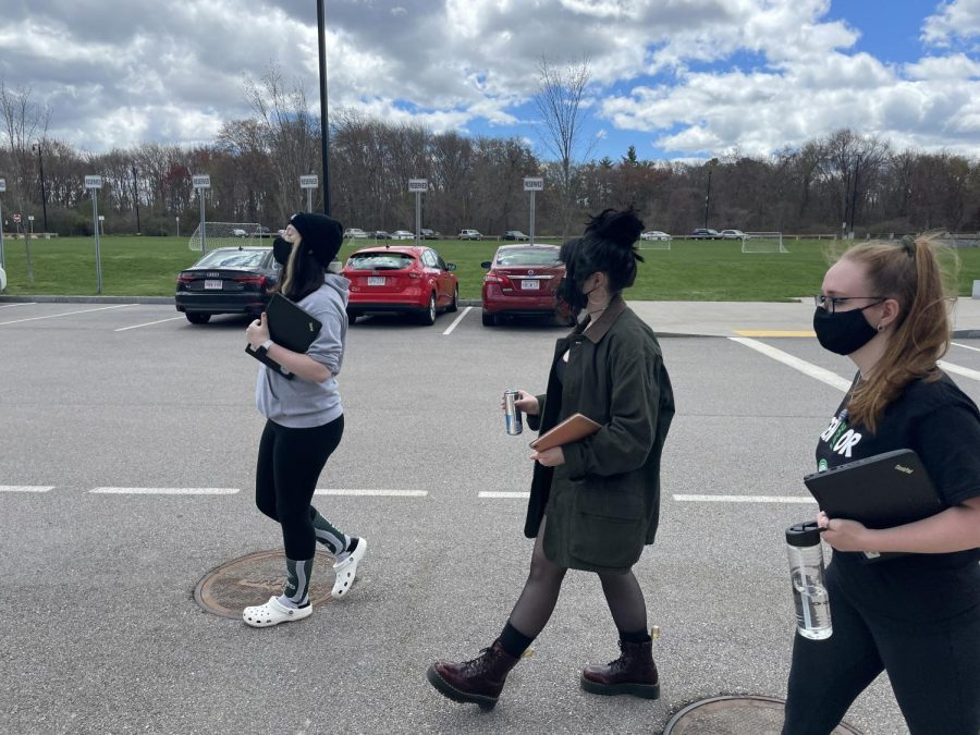 (left to right) Seniors Arianna Akusis, Madelyn O'Leary, and Kathryn Genest take a walk during a break in their AP Literature and Composition class on April 3, 2021 at Abington High School. Today was the last Spirit Week for seniors.