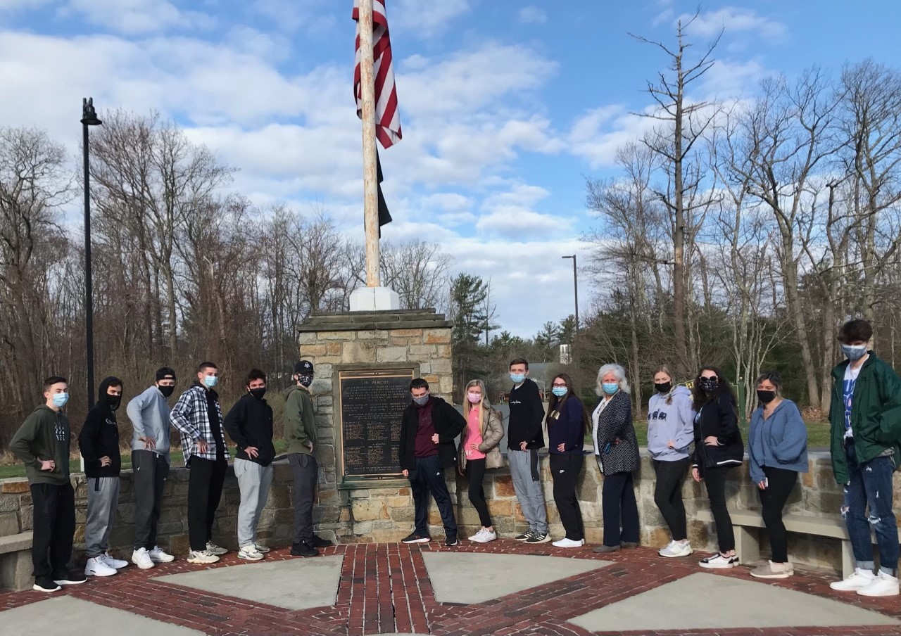 On Wednesday, April 14, 2021,  Ms. Pflaumer and her senior English class gather at the rotary on Gliniewicz Way.