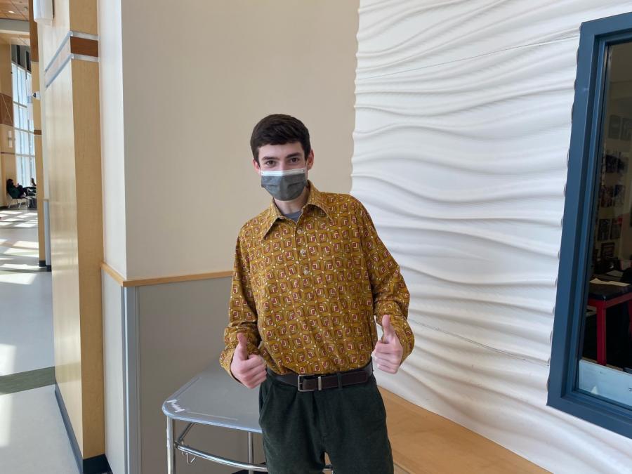 Senior, Brendan Remillard, feeling groovy in his 70's attire in the gym lobby at Abington High School on Wednesday, April 28, 2021.