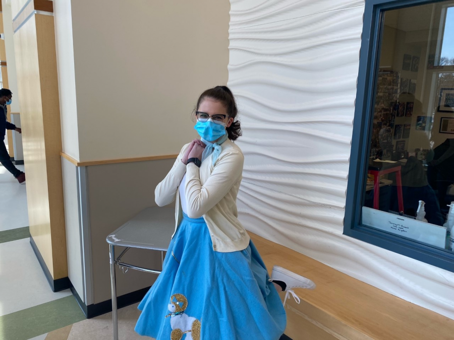 Senior, Isabel Assaf rocking her 50's look by the gym lobby at Abington High School on Wednesday, April 28, 2021.