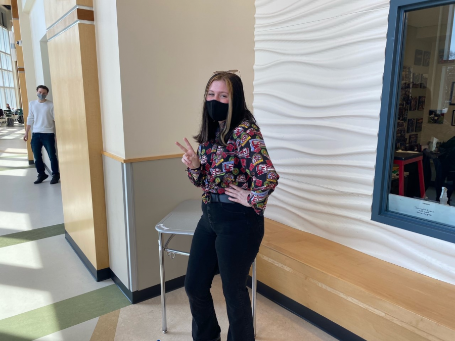 Senior Ariana Akusis, in her 70's wear by the gym lobby at Abington High School on Wednesday April 28, 2021