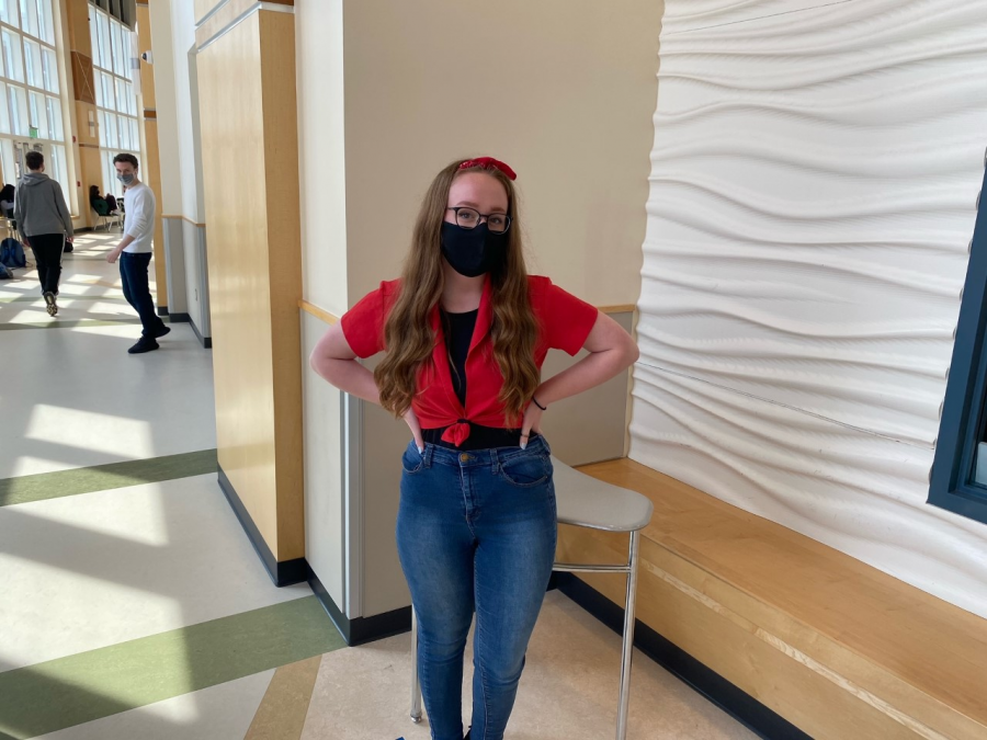 Senior, Kathryn Genest and her classic 60's looks in the gym lobby at Abington High School on Wednesday, April 28, 2021.