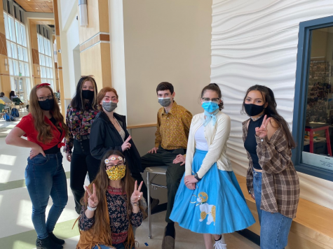 Seniors (left to right) Kathryn Genest, Ariana Akusis, Kylie Zebrasky, Brendan Remillard, Isabelle Assaf, Tatum Kelliher, and Junior Sarah Naidjate representing a variety of decades to celebrate Spirit Week at Abington High School on Wednesday, April 28, 2021.