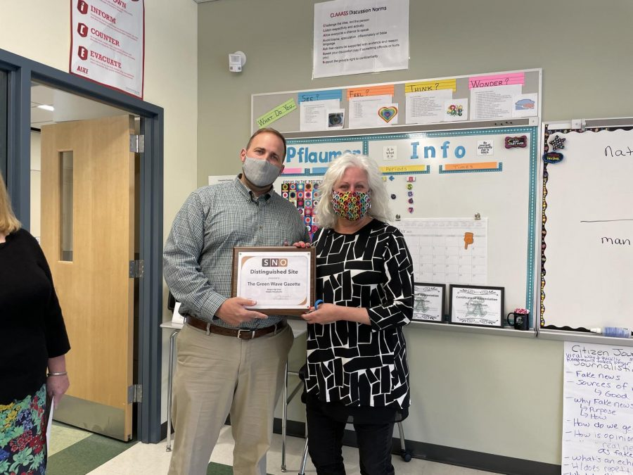 Abington High School Principal Mr. Bourn and English teacher and Green Wave Gazette advisor Ms. Pflaumer after he presented her with the SNO Multimedia award for the Green Wave Gazette at Abington High School on May 7, 2021.