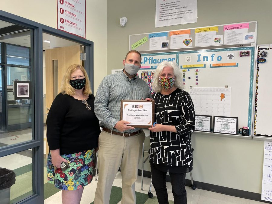 (Left to Right) Abington High School English teacher, Dr. Gonsalves, principal Mr. Bourn, and Green Wave Gazette advisor and English teacher  Ms. Pflaumer after being presented with the SNO Multimedia Award for the Green Wave Gazette at Abington High School on May 7, 2021.