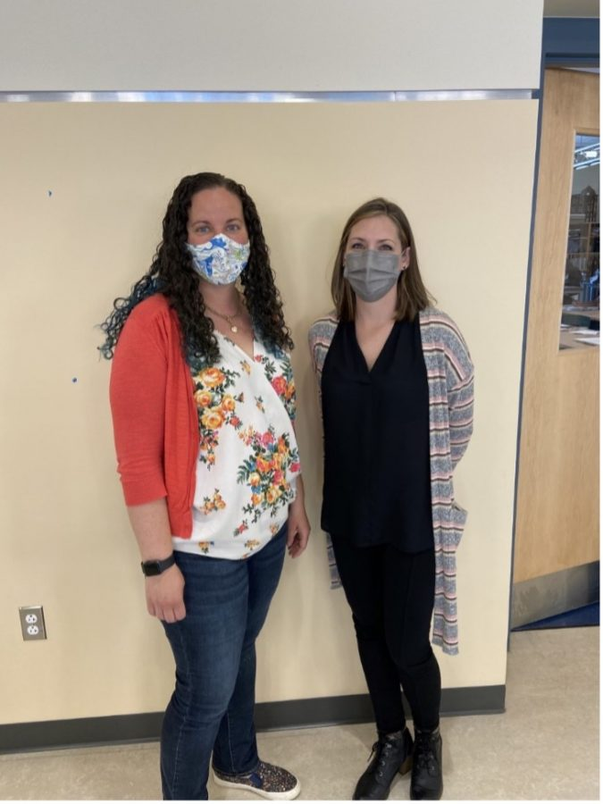 Art teachers Megan Kenealy (left) and Michelle Poirier outside of their second floor art classrooms at Abington High School in May of 2021.