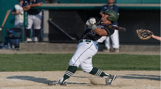 Abington senior Aaron Siegel at bat for the Green Wave in May of 2021.