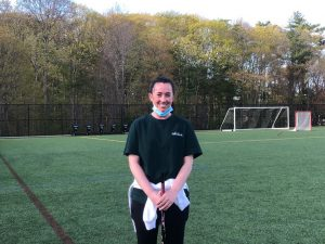 Abington Girls Varsity Lacrosse Coach and former Lacrosse captain (Class of 2012), Kathryn Cawley on the turf field after lacrosse practice on Tuesday, May 11, 2021.