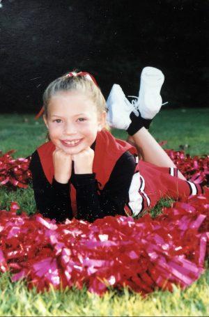 Abington High School Cheerleading coach Ms. Kristin Gerhart (seen here) has been cheering for most of her life.