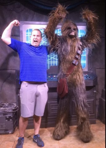 Mr. Jonathan Bourn, principal at Abington High School, poses with Chewbacca at the Star Wars land in Disney. Like many across the world, Bourn, May 4 is a special day to celebrate and Abington High School did this year.