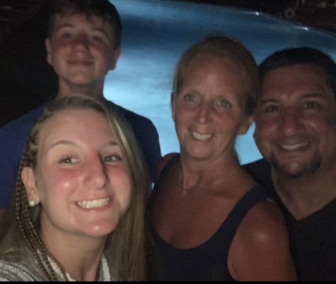 Abington junior Hannah Murphy (left) with her family on December 3, 2019 on the beach in Jamaica.