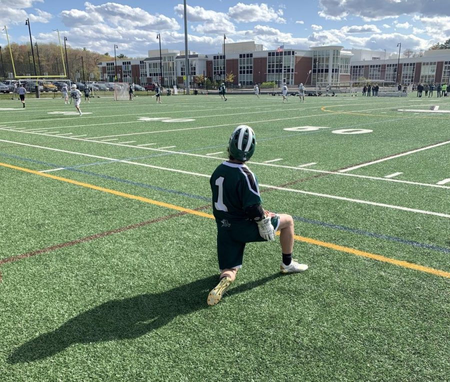 Owen Reardon, #1, catching a break in the penalty box serving his time in the Boys Lacrosse Game on Tuesday, May 11, 2021 at Abington High School.