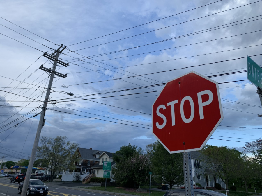 Not all drivers come to a full stop at red lights or stop signs, like this one on Bates Street in Abington, Mass.