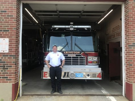 Abington Fire Captain Jarrod Driscoll with engine 4 in the garage of the Abington Fire Department on May 17, 2021.