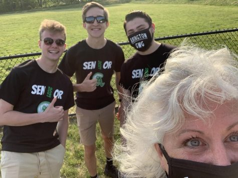 The Weekly Wave digital team (left to right): Aaron Johnson, Derek Tirrell, and Matt Lyons with the newspaper advisor Ms. Patricia Pflaumer during the senior car decorating activity in May of 2021 at Abington High School.