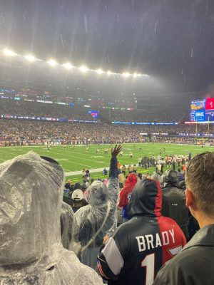 Fans cheer on quarterback Tom Brady during the October 3 game.